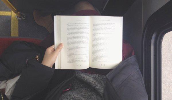 Girl Reading Book Savvy Reader